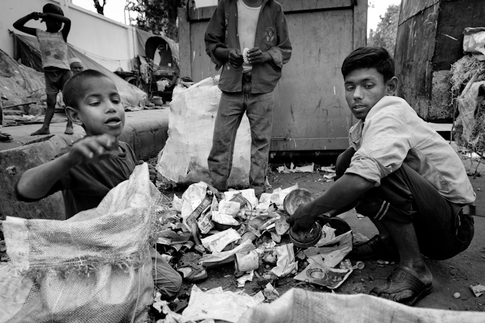 dhaka street life children photography multimedia children in dhaka filter through the garbage dumpsters to any items of use dhaka