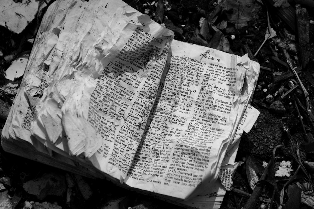 A bible lays in the ruins in the rubble from someones home in Tuscaloosa. This was how I found it... It was open to Psalm 18.
